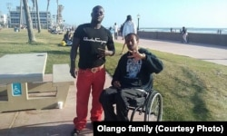 Alfred Olango, left, with his friend, Bereket Demsse.