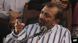 Farooq Sattar, leader of the Muttahida Qaumi Movement, or MQM, addresses a news conference in Karachi, Pakistan, Aug. 23, 2016.