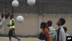 Children attend football training at a ground in Alexandra Township, north of Johannesburg on June 30, 2010. Memories of South Africa 2010 World Cup are fading fast, as its progress halted by a scandal-ridden period off the field since the historic tournament.