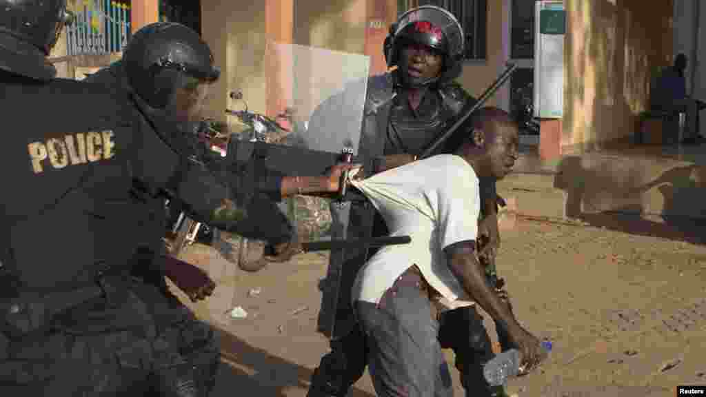 Police arrest an anti-government protester in Ouagadougou, capital of Burkina Faso, Oct. 30, 2014.