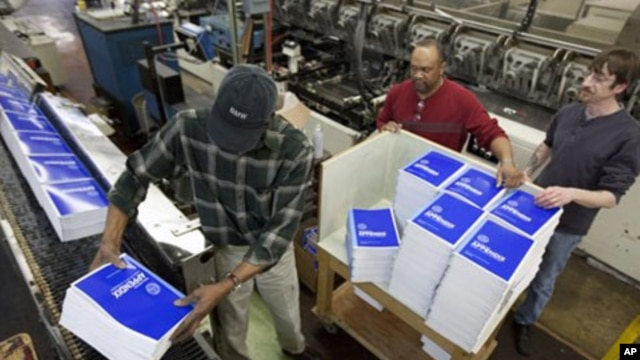 Government Printing Office (GPO) employees work on copies of President Barack Obama's fiscal 2013 budget book, Feb. 9, 2012