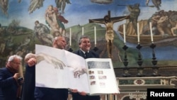 A 1:1 scale photographic book depicting Sistine Chapel is seen during a news conference in the Sistine Chapel, the Vatican, Feb. 24, 2017.