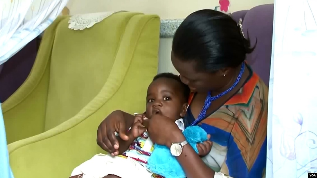 Taka Agnes Wejuli uses the breastfeeding room of the day care center at Uganda's parliament.