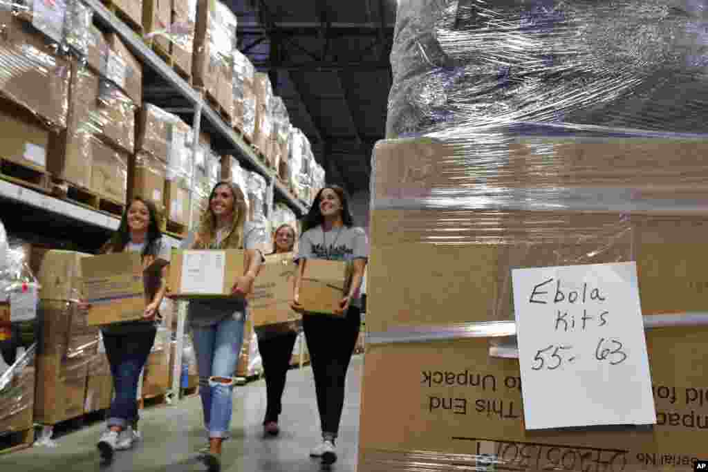 Valor Christian High School sophomores volunteering their time organize medical supplies bound for West Africa to combat Ebola, inside the warehouse of Project C.U.R.E., in Centennial, Colorado,Sept. 9, 2014.