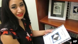 Britt'Nee Brower shows an Inupiat coloring book she published and she talks about the new Inupiat Eskimo language option now available for Facebook bookmarks, action buttons. Alaskans made the option a reality through the social media giant's community tr