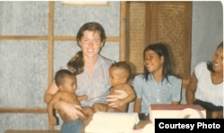 Mary Scully sat with young Cambodian women in the Thai-Cambodia border camp where Scully worked as social health advocate in 1980. (Courtesy Photo of Mary Scully)