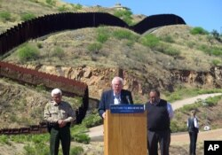 Democratic presidential candidate Bernie Sanders gives a news conference near the U.S.-Mexico international border at Nogales, Arizona, March 19, 2016. He pledged to fight for immigration reform.
