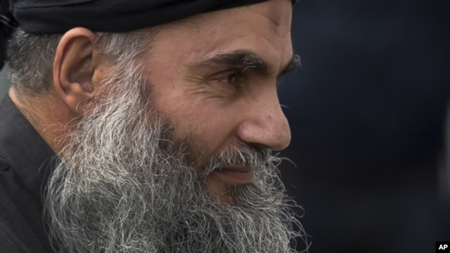 Abu Qatada arrives back at his residence in London after being freed from prison, November 13, 2012.