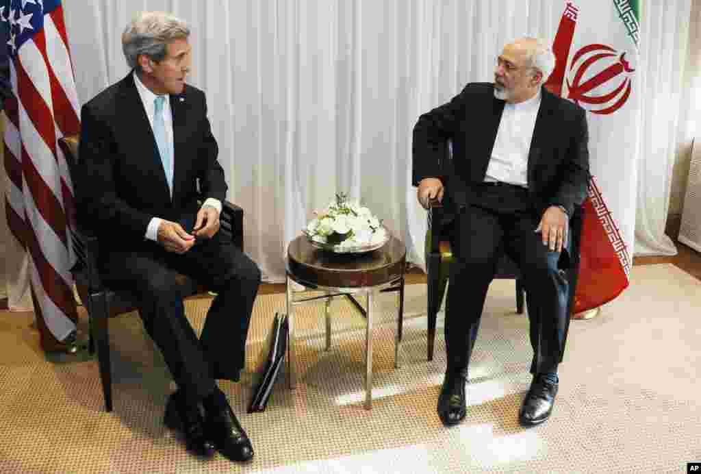 U.S. Secretary of State John Kerry chats with Iranian Foreign Minister Mohammad Javad Zarif before a meeting in Geneva, Switzerland, Jan. 14, 2015.