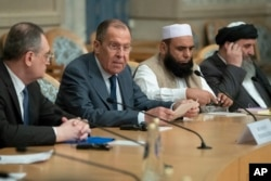 Russian Foreign Minister Sergey Lavrov, second left, speaks as he attends a conference on Afghanistan bringing together representatives of the Afghan authorities and the Taliban in Moscow, Russia, Nov. 9, 2018.