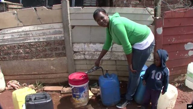 Emily Ntake pumps water in South Africa's Makause community