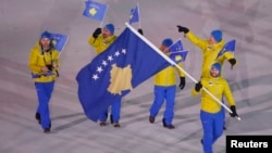 Albin Tahiri of Kosovo carries the national flag during the opening ceremony of the Pyeongchang 2018 Winter Olympic Games at the Pyeongchang Stadium, Pyeongchang, SouthKorea, Feb. 9, 2018.