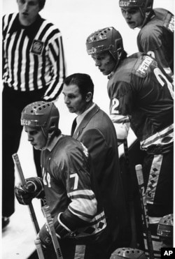 Soviet Coach Victor Tikhonov huddles with Soviet players Aleksei Kasatonov and Viacheslav Fetisof as the last minute counts down in the USA vs USSR ice hockey game in Lake Placid, N.Y. during the Winter Olympic Games on Feb. 22, 1980.