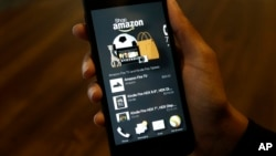 FILE - A photo shows an app that links to online retailer Amazon.com on an Amazon Fire Phone, in Seattle, Washington, June 18, 2014. On Wednesday, the online shopping giant released Spark, its own social media network being described by some as cross between Instagram and Pinterest with a touch of e-commerce.