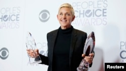 Ellen DeGeneres poses backstage with her Humanitarian Award and Award for Favorite Daytime TV Host during the People's Choice Awards 2016 in Los Angeles, California, Jan. 6, 2016.