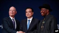 Klaus Schwab, Firayim ministan Chana Li Keqiang da Shugaban Najeriya Goodluck Jonathan.