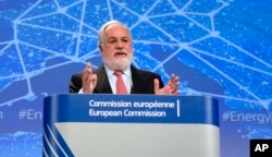 FILE - European Commissioner for Climate Action and Energy Miguel Arias Canete speaks during a media conference at EU headquarters in Brussels, Feb. 25, 2015.