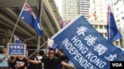 Hàng ngàn người Hồng Kông xuống đường đòi dân chủ nhân kỷ niệm 18 năm ngày thành phố này được Anh trao trả cho Trung Quốc.