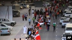 Bahraini anti-government protesters form a human chain Saturday, March 5, 2011, stretching about seven kilometers (four miles) around Manama, Bahrain, from the country's main Fateh Mosque to the Pearl roundabout