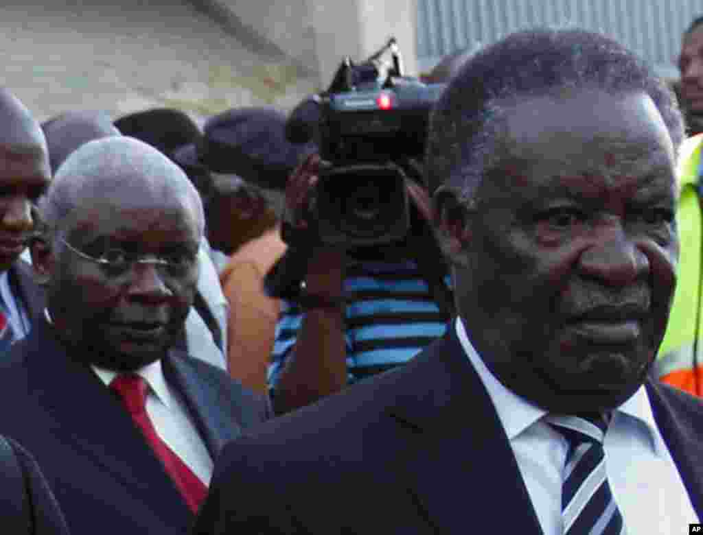 Zambia's President Michael Sata (R) arrives with Mozambique's President Armando Guebuza ahead of the upcoming African National Congress (ANC) centenary celebration in Bloemfontein January 7, 2012. South Africa's ruling ANC celebrates its 100th birthday on