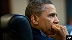 President Barack Obama listens during one in a series of meetings discussing the mission against Osama bin Laden, in the Situation Room of the White House, May 1, 2011.