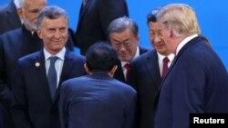 特朗普(右一)與習近平(右二)2018年11月30日在G20峰會上碰面(路透社)