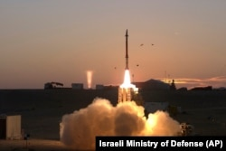 "FILE - A launch of David's Sling missile defense system, Dec. 21, 2015. The Defense Ministry said March 1, 2016, that the David's Sling system ""will allow Israel to more effectively defend against the wide range of current and future threats to its civili"