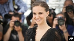 Natalie Portman poses for photographers at the photo call for the film A Tale of Love and Darkness, at the 68th international film festival, Cannes, southern France, May 17, 2015.