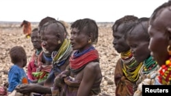 Turkana women wait for food relief at Kalok Tonyang in the Turkana district northwest of Nairobi, August 9, 2011.
