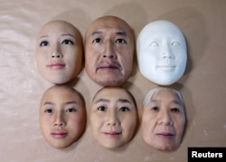 Super-realistic face masks are displayed at factory of REAL-f Co. in Otsu, western Japan, Nov. 15, 2018.