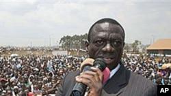 Uganda's opposition leader Kizza Besigye speaks during a rally at Rubaga division in the capital Kampala, Uganda, February 14, 2011