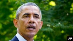 FILE - President Barack Obama in Chilmark, Mass., Aug. 11, 2014,
