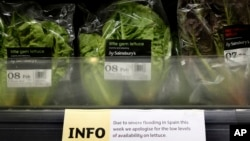 FILE - A sign warning of lettuce shortages is displayed in a supermarket in London, Feb. 3, 2017.