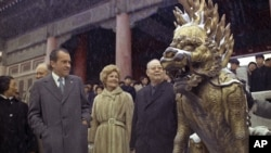 In this Feb 24, 1972 file photo, U.S. President Richard M. Nixon and first lady Pat Nixon are seen as they visit the tombs of Chinese emperors of the Ming Dynasty, in the suburbs of China's capital of Beijing.