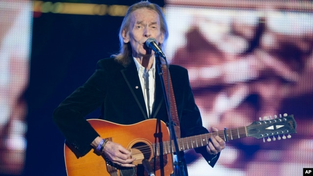 Singer Gordon Lightfoot performs during the CFL's 100th Grey Cup Championship Halftime Show at the Rogers Centre on Nov. 25, 2012, in Toronto.