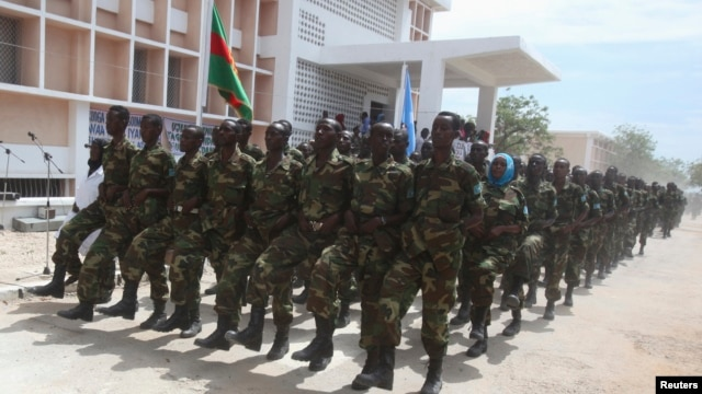 Somali government forces march during a parade to celebrate the 53rd anniversary of the national army, in the capital Mogadishu, April 12, 2013.