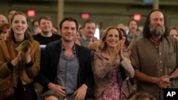 """This image released by Apple TV+ shows, from left, Amy Forsyth, Daniel Durant, Marlee Matlin and Troy Kotsur in a scene from """"CODA."""" (Apple TV+ via AP)"""