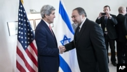 U.S. Secretary of State John Kerry, left, and Israeli Foreign Minister Avigdor Lieberman greet, ahead of their meeting at the David Citadel hotel Friday, Jan. 3, 2014 in Jerusalem, Israel.