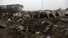 Bezbednosno osoblje na mestu eksplozije u Kabulu, 17. decembar, 2012.