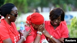 FILE - Security issues are expected to dominate the African Union Summit. As more Nigerian towns come under attack by Boko Haram, '#Bring Back Our Girls' campaigners show support for the missing Chibok schoolgirls at a rally in Abuja, Nov. 3, 2014.