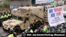 FILE - A U.S. military vehicle, which is a part of Terminal High Altitude Area Defense (THAAD) system, arrives in Seongju, South Korea, April 26, 2017. A South Korean official said Friday the decision to delay full deployment will ensure a democratic process.