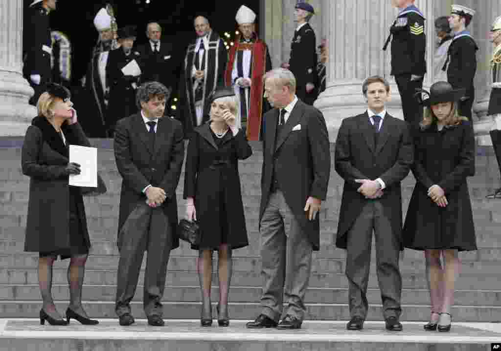 Members of Margaret Thatcher's family from left, daughter Carol Thatcher and partner Marco Grass, Sarah Thatcher, wife of son Mark Thatcher, and grandchildren Michael and Amanda Thatcher after the funeral of former British Prime Minister Margaret Thatcher.