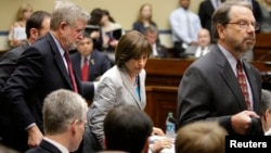 Director of Exempt Organizations for the Internal Revenue Service Lois Lerner (C) departs with her legal team after being excused from a House Oversight and Government Reform Committee hearing on targeting of political groups seeking tax-exempt status fro