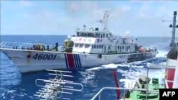FILE - This screen grab from a June 1, 2014 video shows a Chinese Coast Guard ship 46001 chasing a Vietnamese vessel near to the site of the Chinese oil rig in the disputed waters in the South China Sea, off Vietnam's central coast.