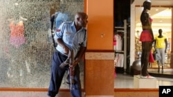 Police officer tries to secure area inside Westgate Shopping Centre after gunmen went on a shooting spree, Nairobi, Sept. 21, 2013.