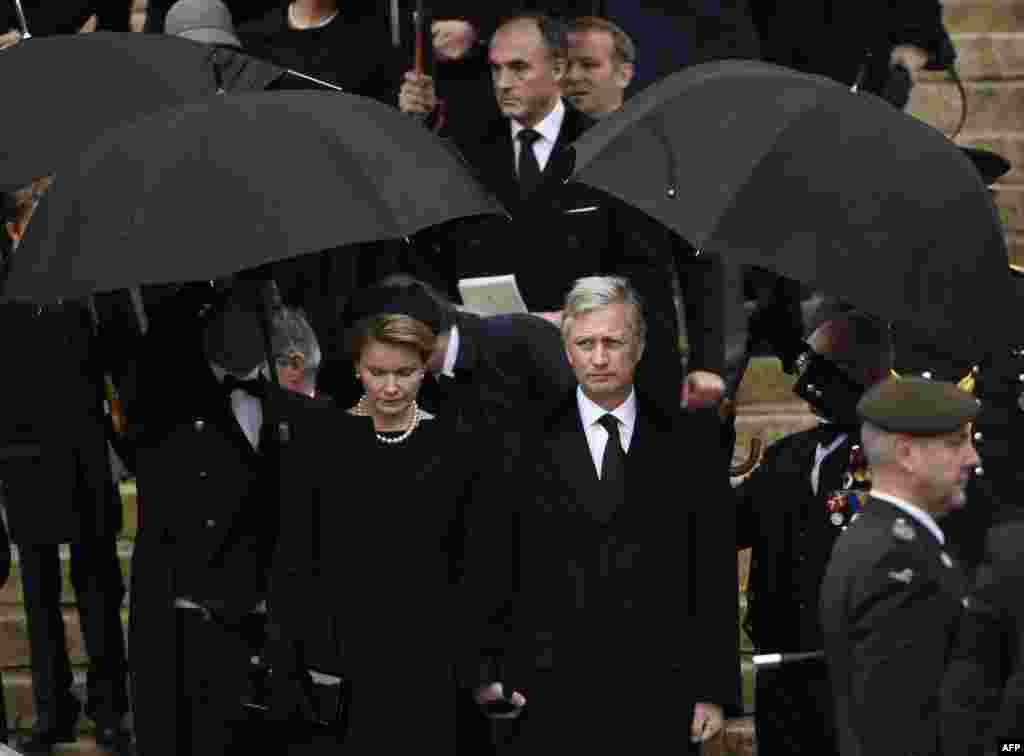 Belgium's King Philippe and Queen Mathilde and Prince Lorenz leave the funeral service of the late Queen Fabiola, at the Cathedral of St. Michael and St.Gudula, in Brussels. Queen Fabiola passed away December 5 at the age of 86.