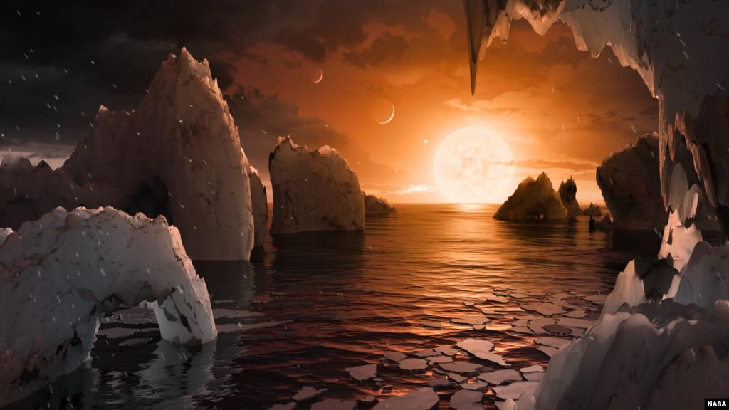 រូបភាពនេះបង្ហាញពីផ្ទៃនៃភព TRAPPIST-1f ជាភពដែលគេទើបតែរកឃើញក្នុងប្រព័ន្ធ TRAPPIST-1។ អ្នកវិទ្យាសាស្រ្តដែលប្រើកែវពង្រីកលំហ (Spitzer Space Telescope) និងកែវពង្រីកនៅលើដីបានរកឃើញថាមានភពទំហំប៉ុនផែនដីចំនួន៧នៅក្នុងប្រព័ន្ធនេះ។