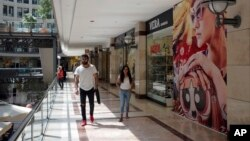 People walk in a shopping mall in Ankara, Turkey, Aug. 15, 2018. Turkey announced increased duties on U.S. products, including cars, tobacco and alcohol, on Wednesday in retaliation against U.S. sanctions and tariffs on Turkey in a continuing feud over the detention of an American pastor.