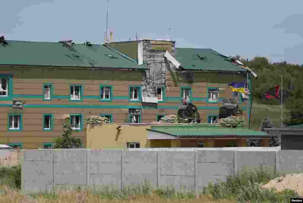 Damaged buildings are seen at a Ukrainian border guard camp, after what local residents say was an attack by pro-Russian separatists, on the outskirts of the eastern Ukrainian city of Luhansk June 3, 2014.