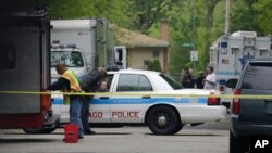 FILE - Police cordon off an area where a possible murder suspect has fired shots in Chicago.